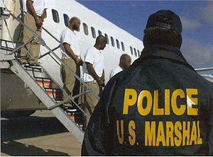 Justice Prisoner and Alien Transportation System - Image: JPATS prisoners stepping down an aircraft