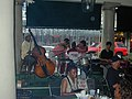 Jazz entertainment at the Market Cafe, New Orleans, July 2004.jpg