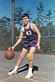 Jeb Bush in basketball uniform during youth.jpg