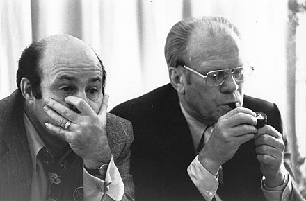 Gerald Ford (right) watching election returns with Joe Garagiola on election night in 1976. Garagiola is reacting to television reports that Ford had just lost Texas to Carter. Joe Garagiola-Gerald Ford.jpg