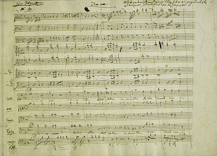 Facsimile sheet of music from the Dies Irae movement of the Requiem Mass in D minor (K. 626) in Mozart's handwriting (Mozarthaus, Vienna) K626 Requiem Dies Irae.jpg