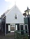 foto van Gedeeltelijk bakstenen huis