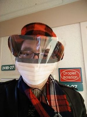 Influenza A virus subtype H3N2 - A man wearing a procedure mask prior to taking his octogenarian father home on Christmas 2014.