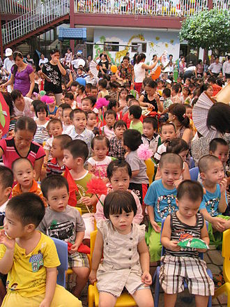 Kindergarten - A kindergarten class in Hanoi, Vietnam engaging in typical group activities such as playing with toys