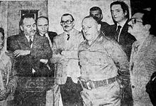 Black-and-white photo of Kirchner and other local politicians