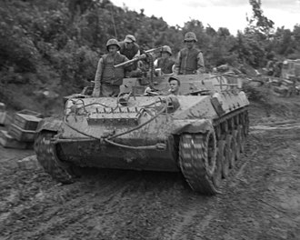 "Battle of the Samichon River - A U.S. Army M39 Armored Utility Vehicle assists U.S. Marines picking up casualties on 25 July 1953 during an attack against Hill 111, also known as ""Boulder City."""