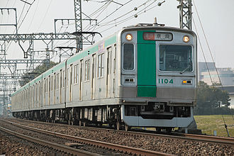 Karasuma Line - A 10 series (first batch) EMU on an express service bound for Kintetsu Nara