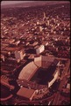 LINCOLN, THE CAPITAL CITY, SEEN FROM THE AIR. IN FOREGROUND IS THE UNIVERSITY OF NEBRASKA STADIUM - NARA - 547431.tif