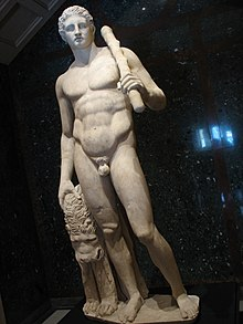 Statue of Heracles, holding a club and caressing a lion