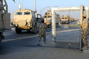Withdrawal of U.S. troops from Iraq - Kuwaiti soldiers man a border crossing in December 2011, as the last of the U.S. military convoy crosses the border from Iraq into Kuwait, completing the withdrawal.