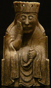Photograph of an ivory gaming piece depicting a seated queen