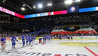 Players from the ZSC Lions line up prior to a game. The club plays in the Swiss National League A. Lineup (5154107439).jpg