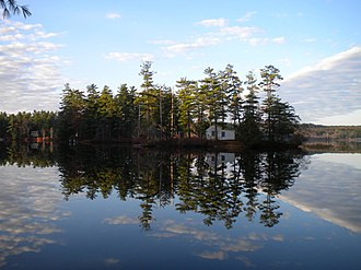 Gray, Maine - A clear view of Loon Island on a calm day on Forest Lake