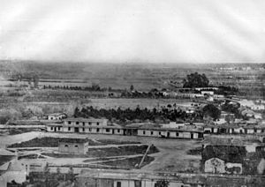 William G. Dryden - In a photograph of Los Angeles, about 1858, this little brick reservoir in the center of the Los Angeles Plaza was the end point of Dryden's waterworks zanja.