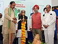 M. Venkaiah Naidu lighting the lamp to inaugurate the first National Consultation on Strengthening of Local Self Government on the theme 'Swarajya to Surajya', organised by Indian Institute of Public Administration.jpg
