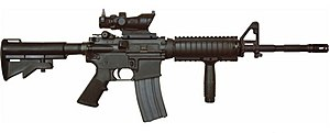 M4 carbine - Colt M4A1 Carbine with ACOG optic and a vertical forward grip