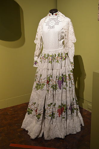 Poplin - Poplin dress embroidered with grape vines from Aguascalientes at the Museo de Arte Popular in Mexico City.