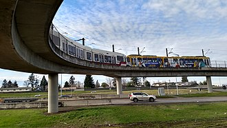Gateway/Northeast 99th Avenue Transit Center - Red Line train on the curved bridge south of the station