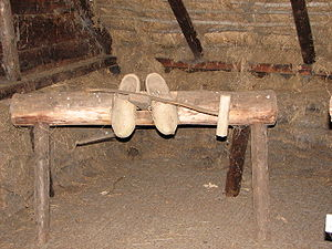 Stock knife - A stock knife on the bench it was used with and a pair of clogs it was used to make.