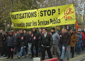 Revolutionary Communist League (France) - LCR protesters marching in a workforce demonstration in favour of public services and against privatisation