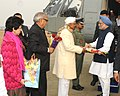 Manmohan Singh being received by the Governor of Haryana, Shri Jagannath Pahadia, on his arrival at Fatehabad Helipad, in Haryana. The Chief Minister of Haryana.jpg