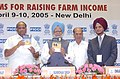 """Manmohan Singh releasing a publication titled """"State of the Indian Farmer A millennium Study"""" at the inauguration of Agriculture Summit 2005 – """"Reforms for Raising Farm Income"""", in New Delhi on April 9, 2005.jpg"""