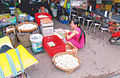 Market woman with a lot eggs Vietnam.jpg