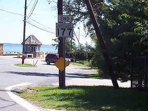 Maryland Route 177 - Eastern terminus of MD 177 with the gatehouse at the entrance to Gibson Island in the background