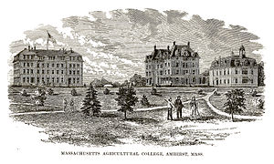 University of Massachusetts Amherst - Massachusetts Agricultural College as it appeared in 1879, with students and faculty standing in front of Old South College, North College, and the college's first chapel.