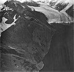 McCarty Glacier, terminus of tidewater glacier, hanging glaciers on the mountainsides, September 4, 1977 (GLACIERS 6634).jpg