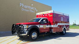 Ambulance - A modern American ambulance built on the chassis of a Ford F-450 truck, with extensive external storage