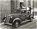 Men loading hardware into new GMC Model T truck Milwaukee WI 1936.jpg