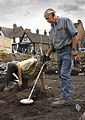 Metal detecting in progress on a Time Team dig (2).jpg