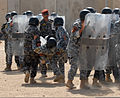 Ministry of Interior Iraqi Federal Police officers perform a riot control demonstration in the civil disorder management course on Camp Dublin, Baghdad, Iraq, Aug 20, 2011 110820-A-QM174-101.jpg