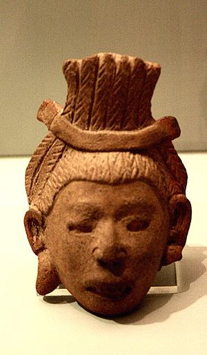 "Aztec warfare - Head of an Aztec warrior with a ""temillotl"" top knot, Museo de América, Madrid, Spain"