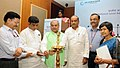 Narendra Singh Tomar lighting the lamp to inaugurate the National Level Advocacy Workshop on Rural Road Maintenance Policy, in New Delhi.jpg