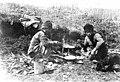 Native men, possibly Siberian Eskimos, eating meal prepared over fire, location unknown, ca 1899 (WARNER 596).jpeg