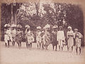 Natives of Central India carrying small packs on their head (unknown date).jpg