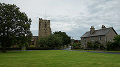 Natland village green and St Mark's church.jpg