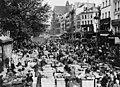 Nearly identical views of street market in Paris, France.jpg
