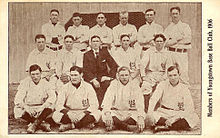 Group of 15 men standing in three rows.