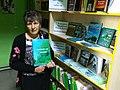 Olha Rudnyk and her books.jpg