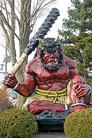 Oni - A statue of a red oni wielding a kanabō.