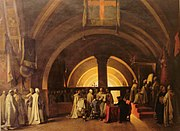 Painting of dozens of men in white robes in a domed chapel. A young man with short black hair and dark blue robe is kneeling on a stool in the center, and pointing at something in a large open book which is being held by one of the white-robed men.