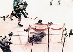 History of the National Hockey League (1967–92) - Bobby Orr in the process of being tripped, scores the Stanley Cup winning Goal. Notice the puck in the net and the goal light has not yet come on.