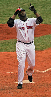 David Ortiz points to the sky as he steps on home plate.