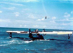 PBY taxiing with N3N flying overhead.jpeg