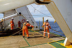 Personnel heave in the soft tow cable attached to the Dragon Prince deep tow fish during the recovery of the deep tow as Fugro Discovery completes the first stage of the search for the missing Malaysia Airline.jpg