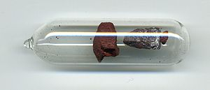Allotropes of phosphorus - Violet phosphorus (right) by a sample of red phosphorus (left)