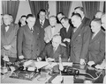 Photograph of President Truman at his desk in the Oval Office, signing S. 790, an act granting the consent of the... - NARA - 200104.tif